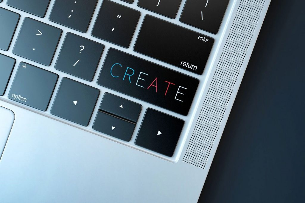 laptop key board with the word create on the shift key