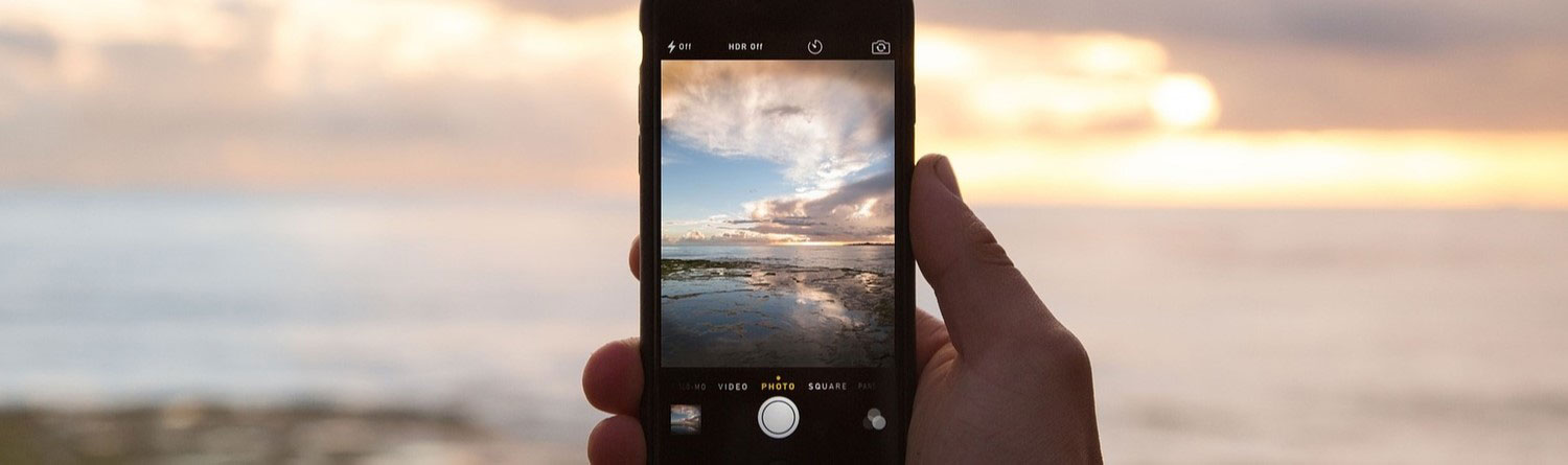 Taking a photo of beach with a cell phone